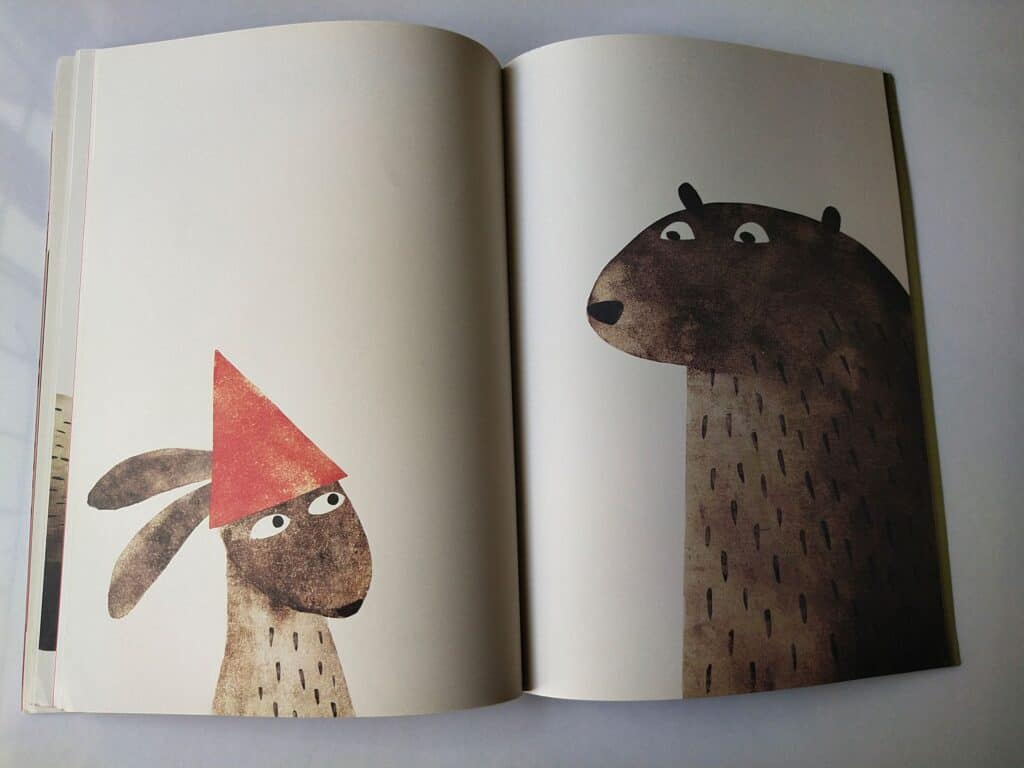 Bear catches the rabbit with the hat.
