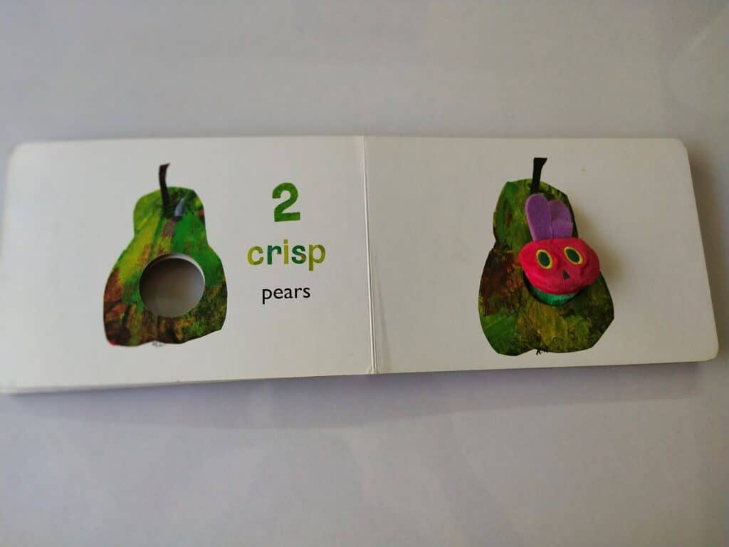 Hungry caterpillar eating two pears.